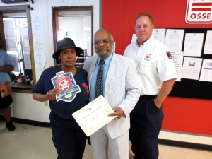 Left to right: Myrtis Gant, Driver of the Month (June) at Adams Place, with Novell Sullivan, OSSE DOT community outreach officer, and Thomas Farrell, deputy terminal manager at Adams Place Terminal.